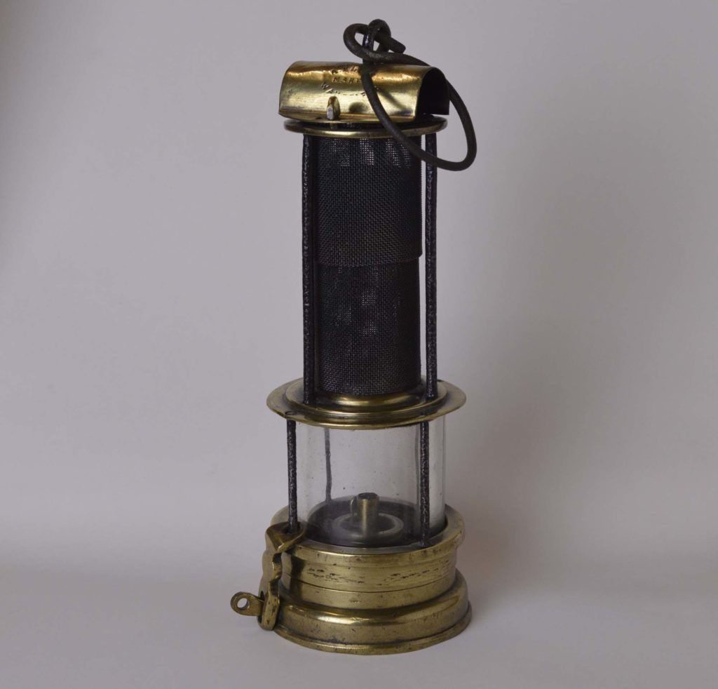 A Photo Of A Lamp With Brass To And Base Beneath A Circular Brass Chamber Lamp Oil Lamps Visual