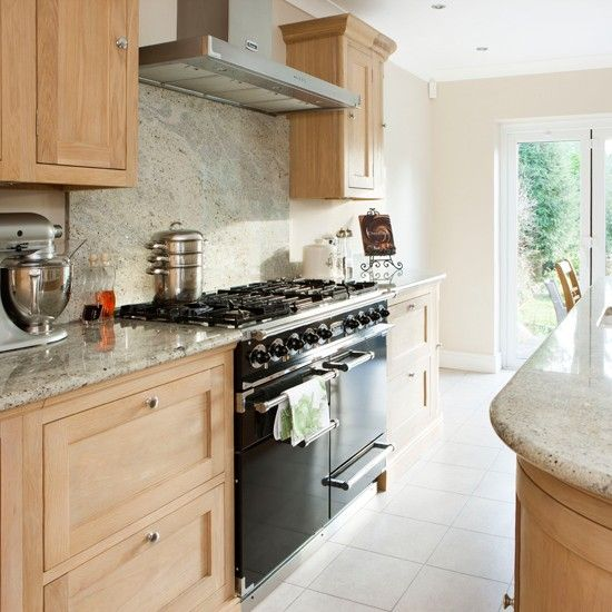 Cream Kitchen Black Worktops: Oak And Cream Kitchen With Range Cooker The Texture Of The