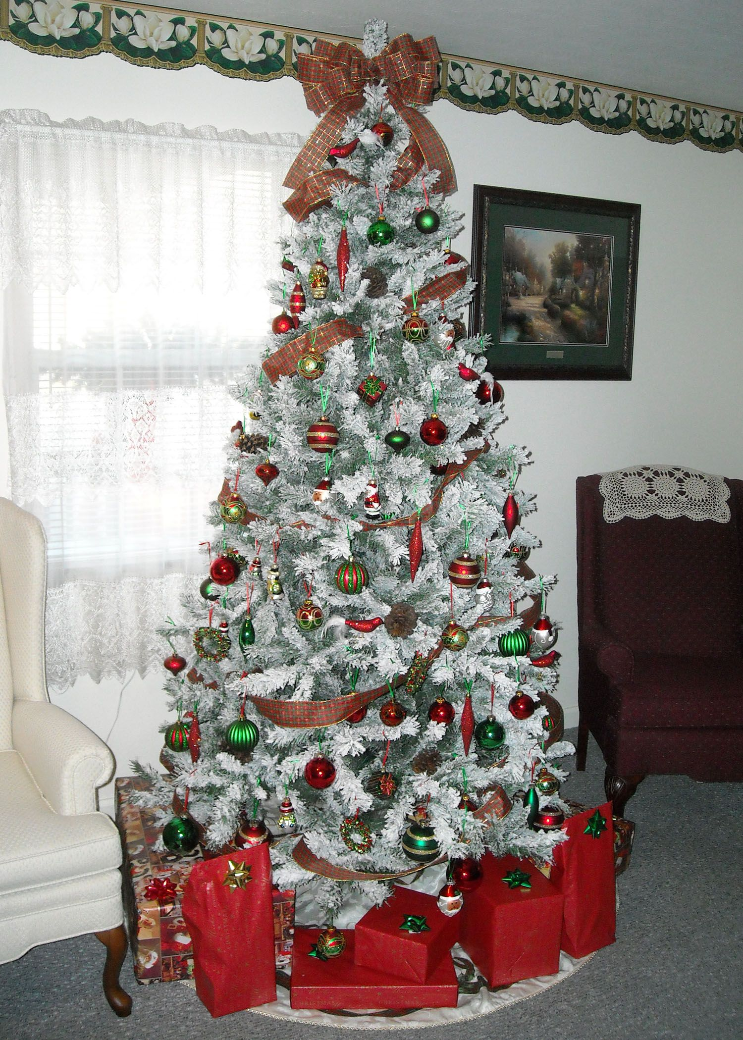 This is my snow flocked tree with a plaid red green and gold
