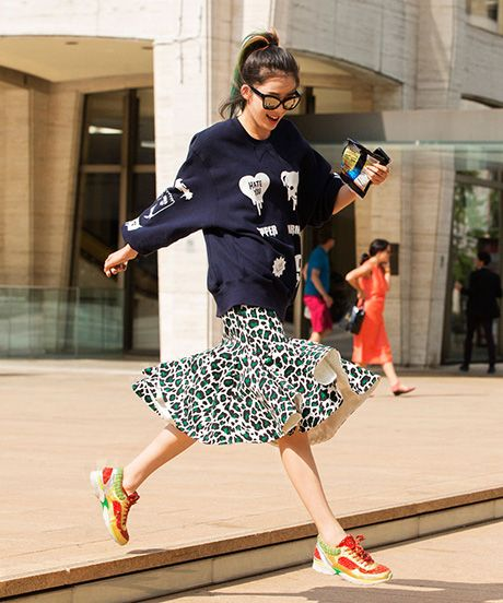 cool Sweatshirt with printed skirt & colorful sneaks.  Which Fashion Sweatshirt Is Right For Your Style?  #refinery29