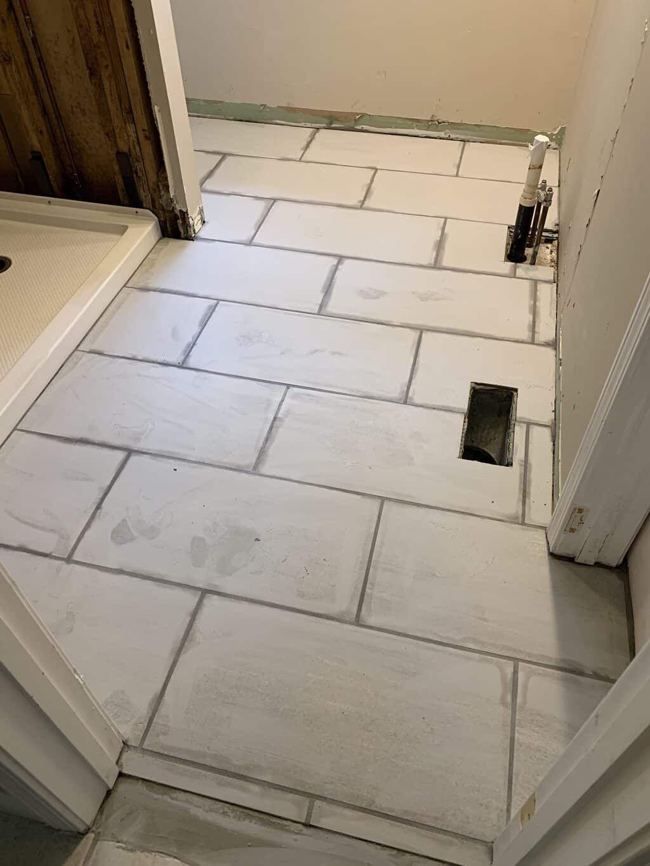 How To Install Tile On A Bathroom Floor Bathroom Flooring Tile Installation Tile Floor Diy