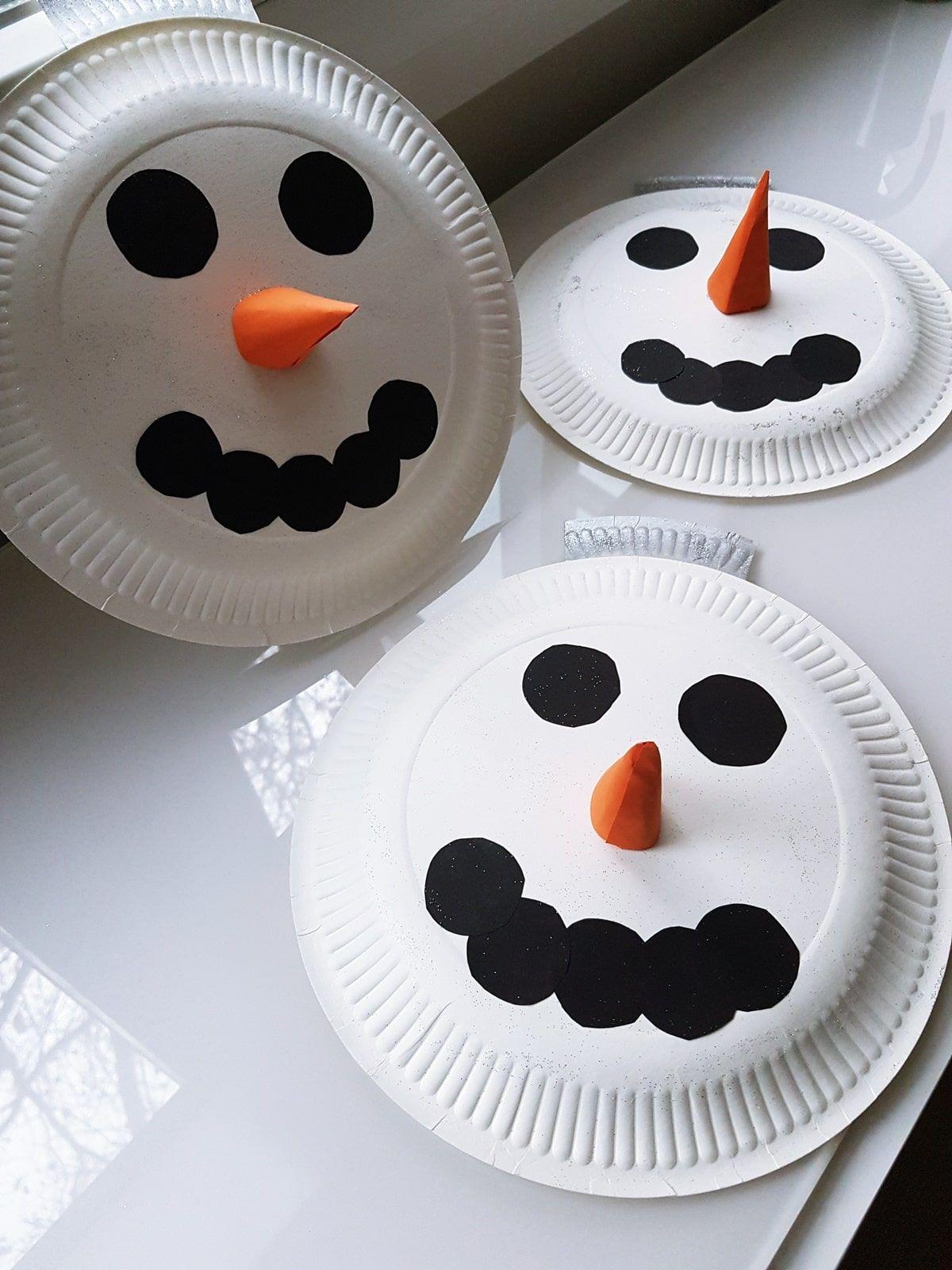 Schneemann Pappteller Girlande basteln mit Kindern #winterbastelnkinder
