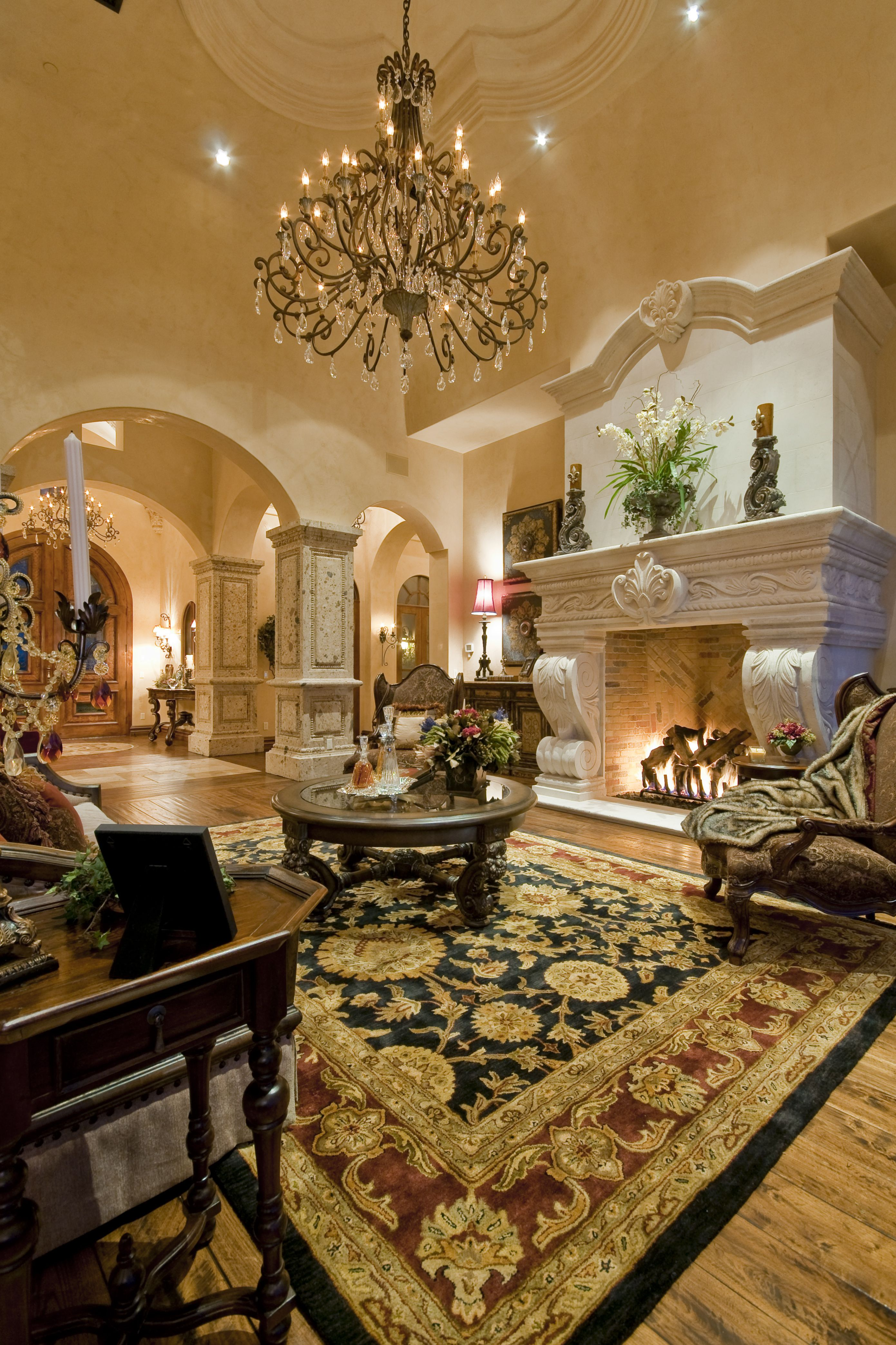Elegant Family Room With A Large Fireplace And Mantel Traditional
