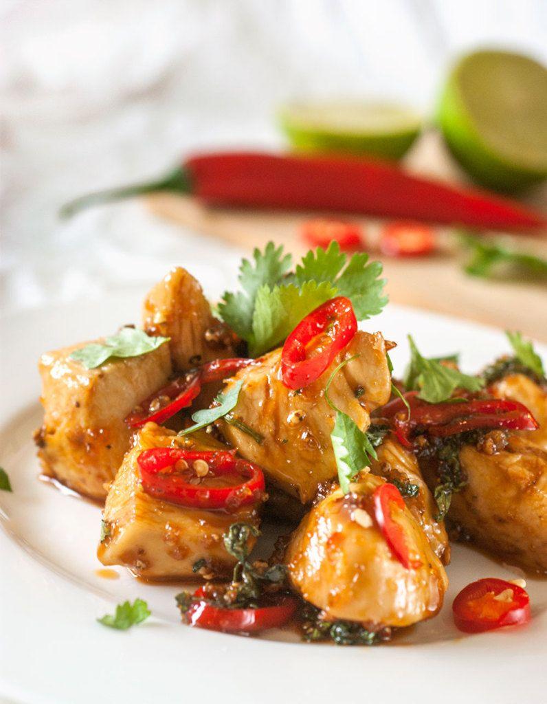 Spicy garlic thai chicken served on a white plate garnished chili spicy garlic thai chicken served on a white plate garnished chili and cilantro forumfinder Choice Image