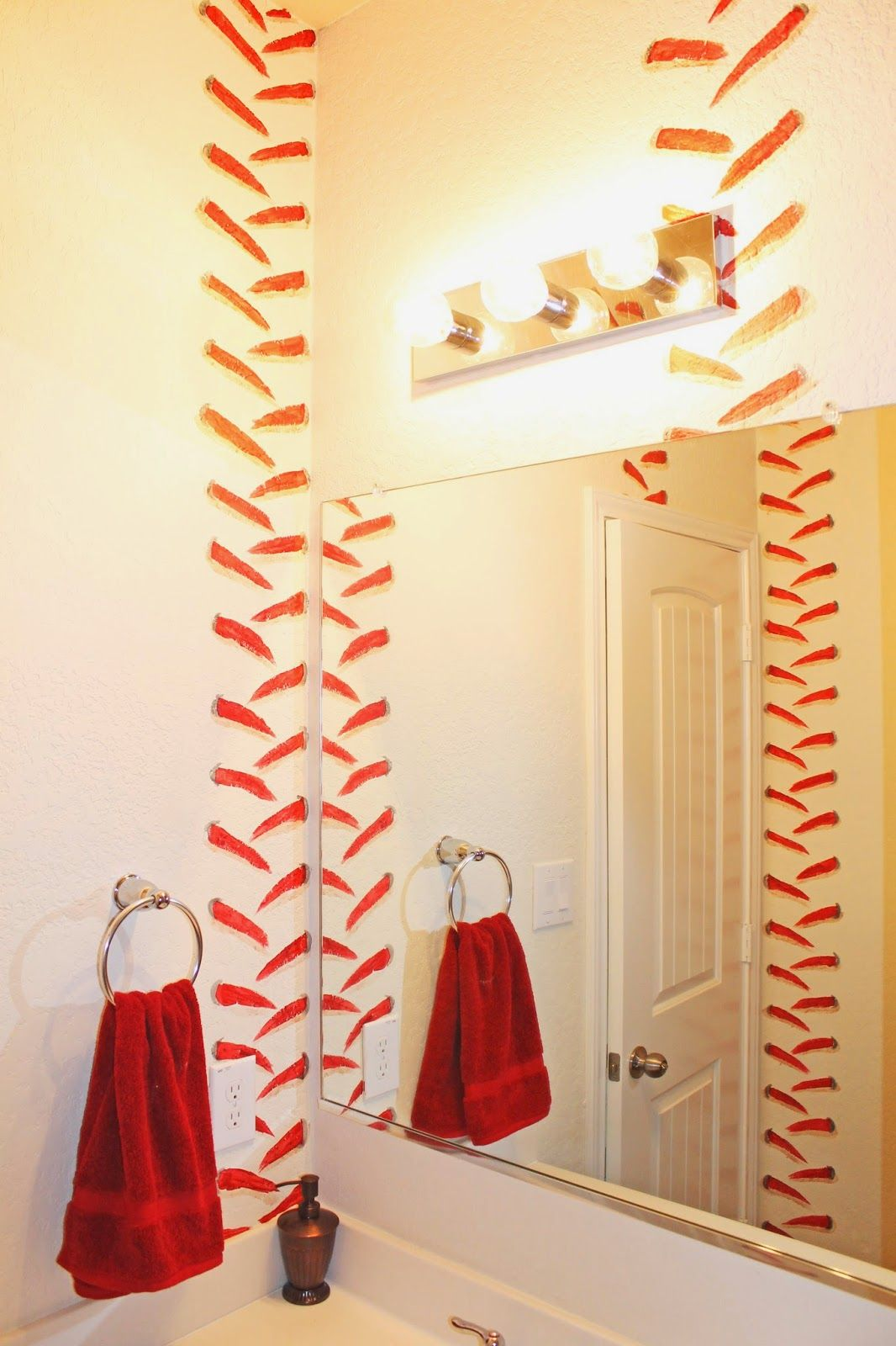 boys baseball themed bathroom. stitching painted in stripes on