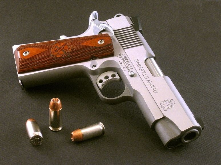 Springfield 1911 A1 - Springfield Armory- I prefer revolvers, but the Springfield 1911 is pretty damn sweet... wish I had one.