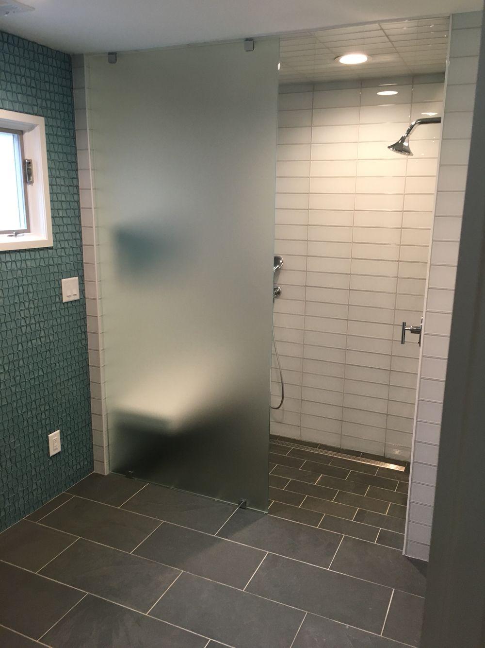 Glass tile Curb less shower Linear drain Steam shower Curb less
