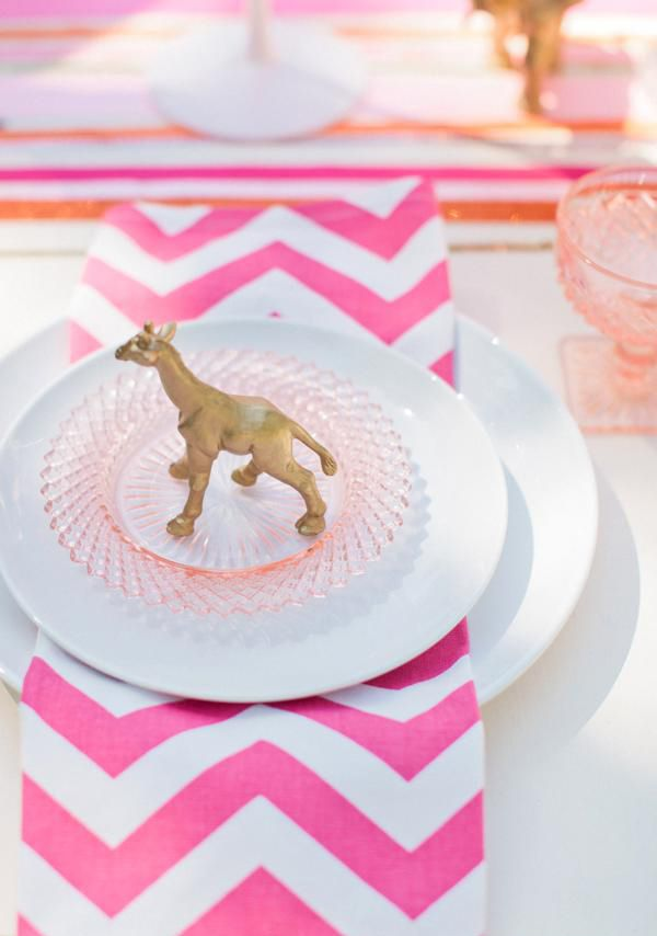 DIY Gold spray painted animals. Adds a whimsical touch to tablescape as place card holders.