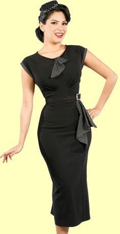 Another glamorous design from Stop Staring! This 40's inspired black dress features a keyhole neckline with polka dot flap, cap sleeves with polka dot accent, belted waist with polka dot flap, back zip and back slit.