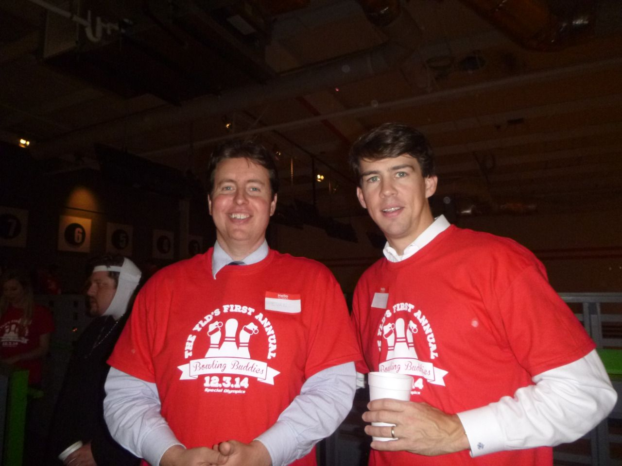 #Lawyer Evan Guthrie with Cooper Wilson of Hood Law Firm at the South Carolina Bar Young Lawyers Division Bowling Buddies event featuring young attorneys cheering on South Carolina Special Olympics athletes on as they bowl at The Alley in Charleston, SC on Wednesday December 3, 2014