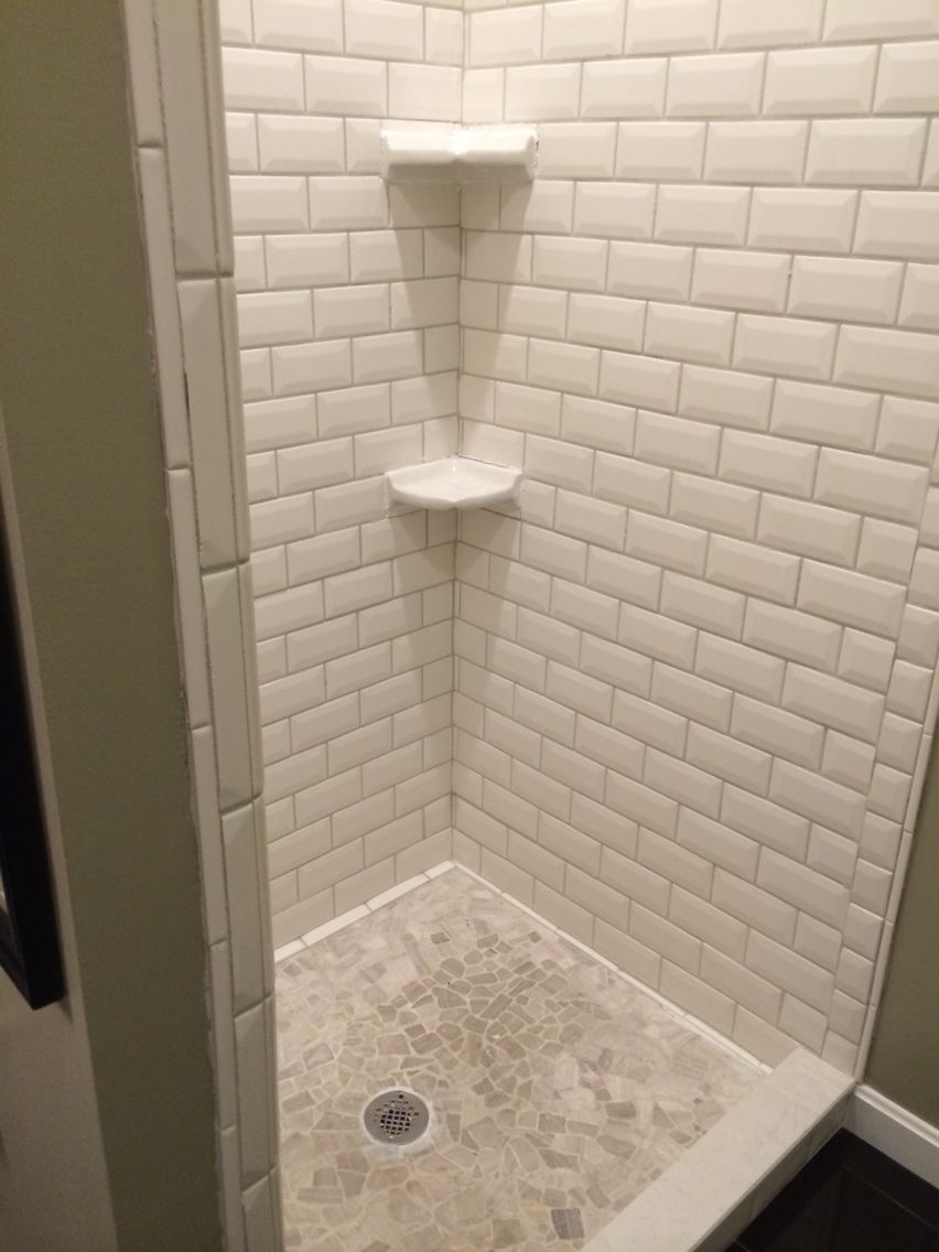 New shower enclosure with beveled white subway tiles and natural ...