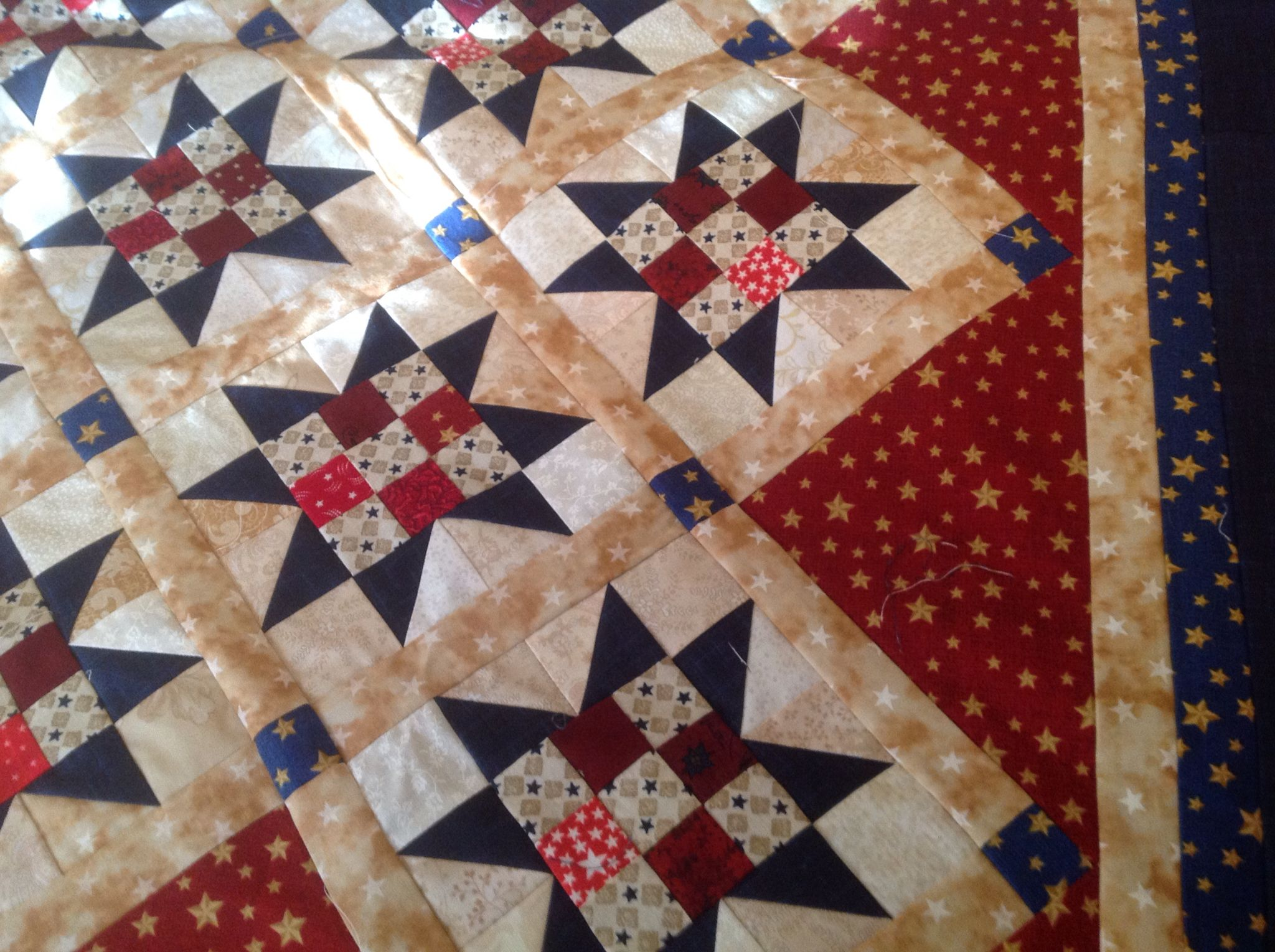 Close Up Of Scrappy Red White Blue Ohio Star Quilt Top
