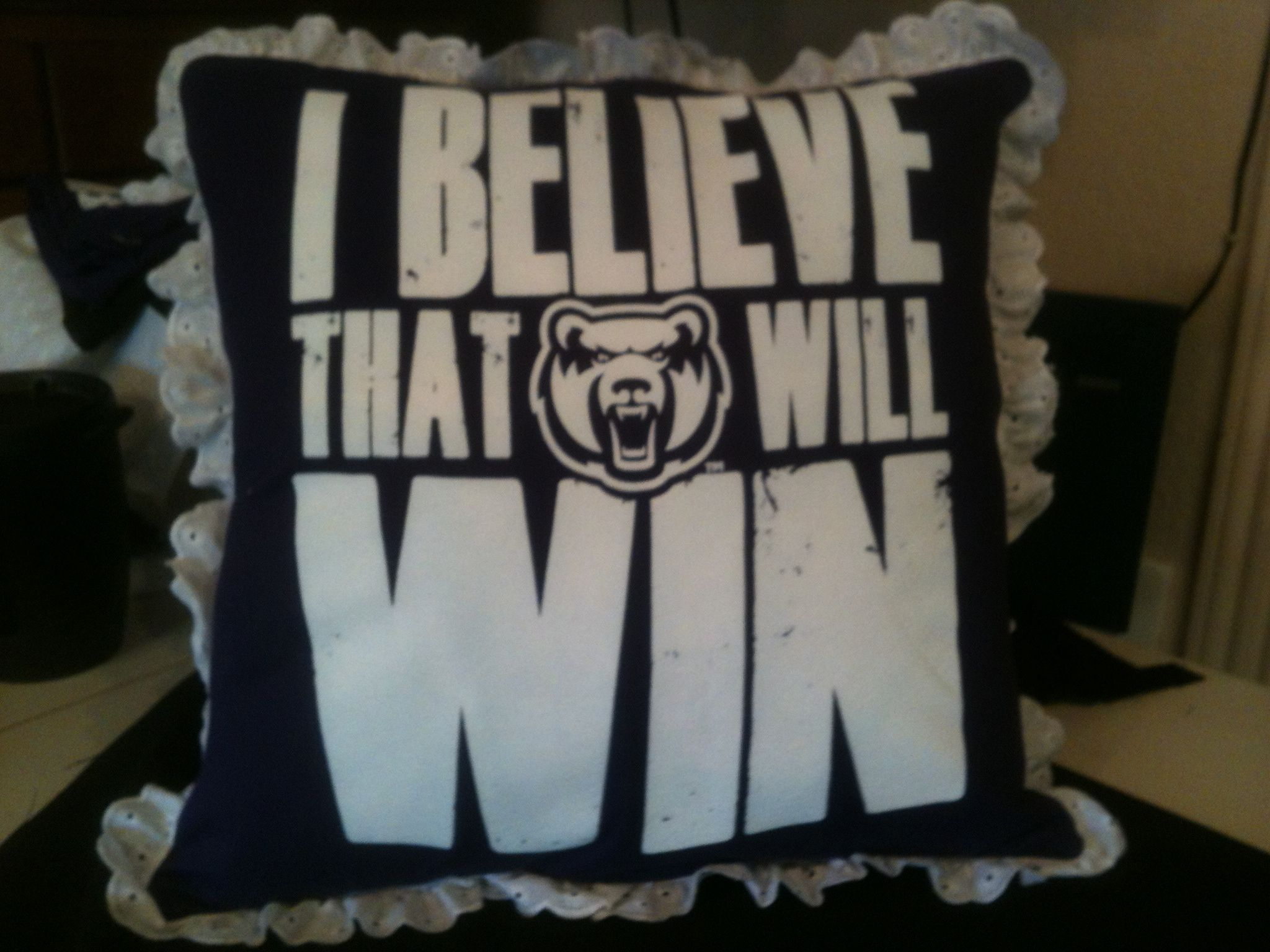 This pillow was made from the front of the t-shirt that the Game Day dress was made.