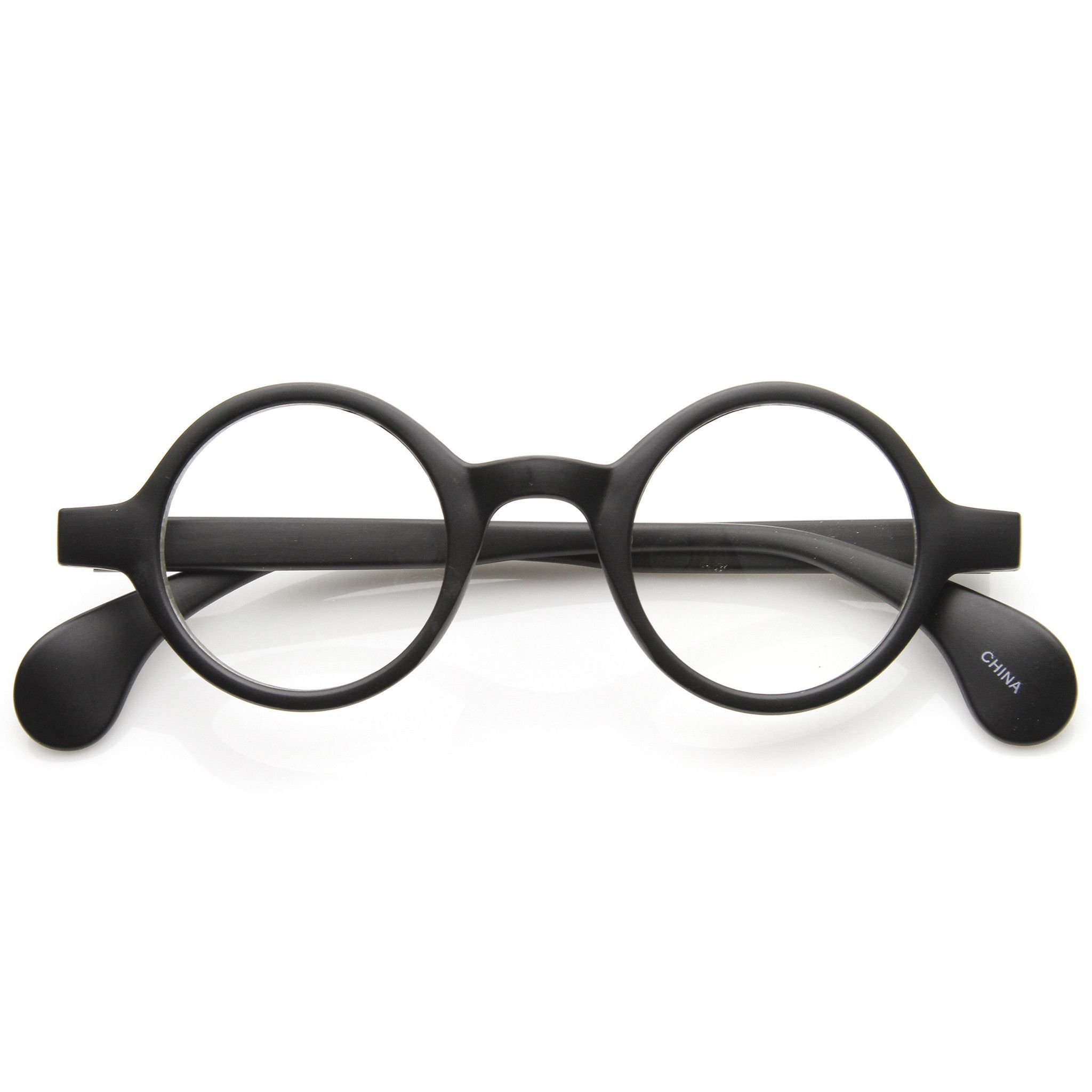9a84b882fd7 Description - Measurements - Shipping - Classic round Lennon style frame  that features horned rim temples with bold end tips and clear lenses.