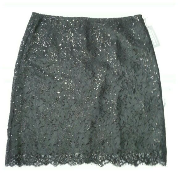 "SALEEmmeline Lace Mini Skirt Lightweight lace mini skirt with metallic threads. Great party skirt. No waistband, side zip, fully lined, 18"" length. Nylon/silk, dry clean. Velvet Skirts Mini"