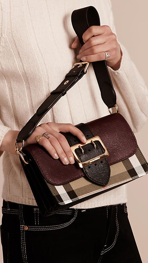 The Buckle Bag in English-woven House check cotton and textured leather  from Burberry. Made in Italy, the design has a regimental belt detail with  a ... d589e0158ad