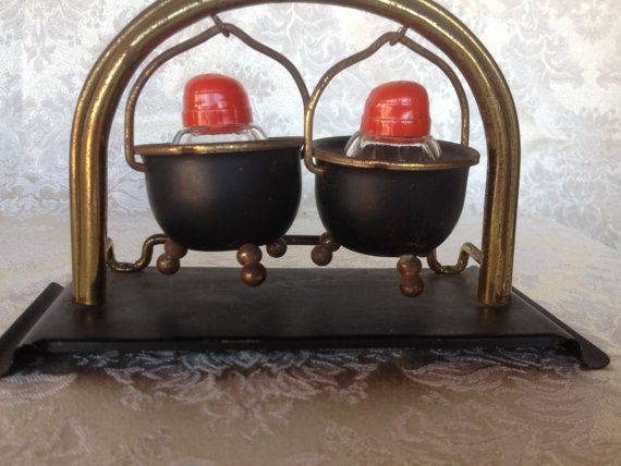 Lovely Vintage Salt and Pepper Shaker set Black metal pots w/ brass handles swing small glass salt and pepper shakers with red plastic tops on Etsy, $14.95