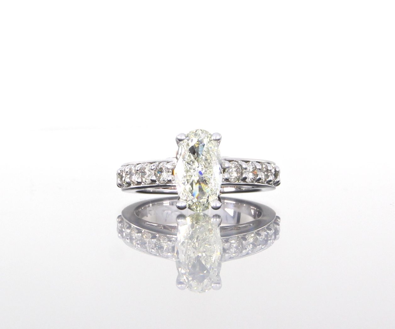 Oval diamond engagement ring in white gold custom made at craft