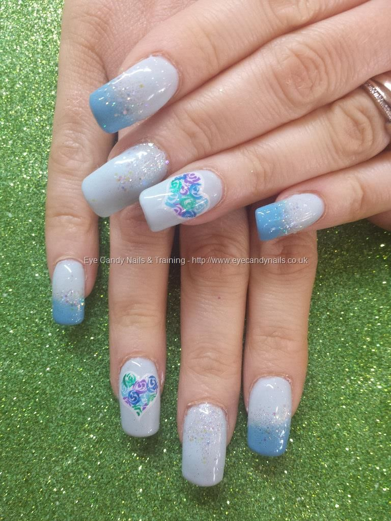 Blue fade gel polish with freehand nail art and glitter