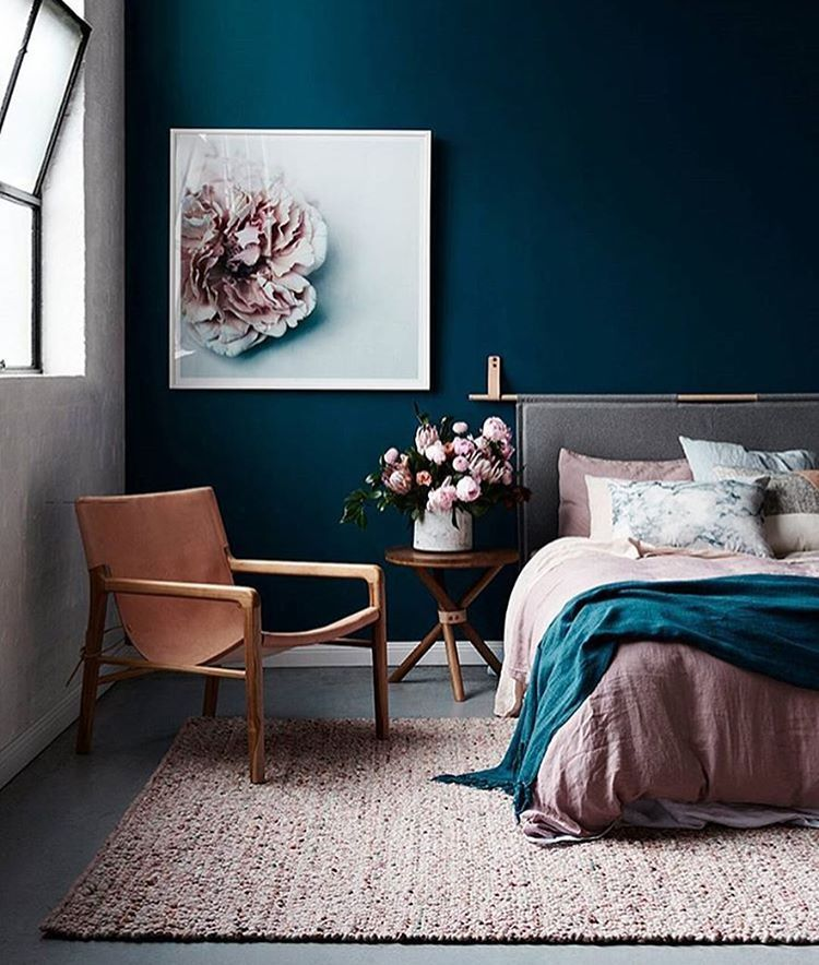Gorgeous dark blue walls and blush accents bedroom