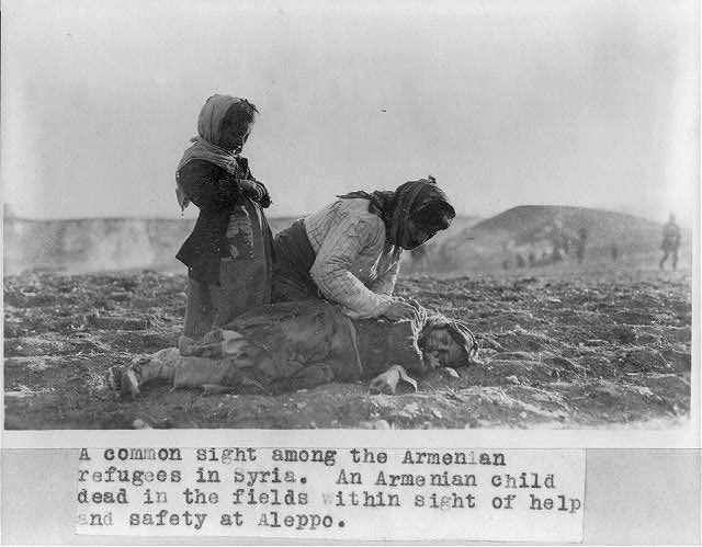 Syria - Aleppo - Armenian woman kneeling beside dead child