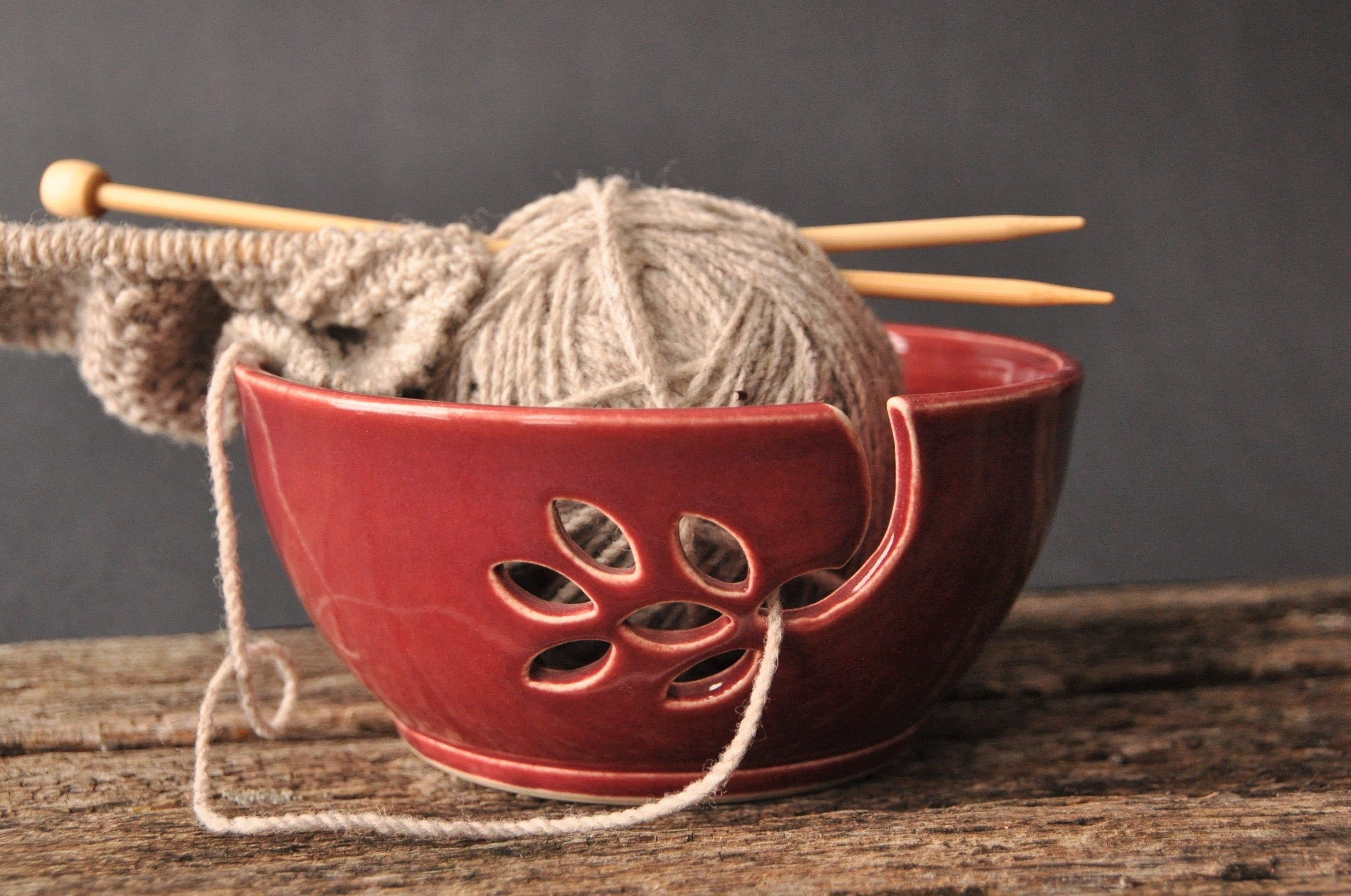 Red ceramic yarn bowl with oak leaf, crochet bowl, pottery wool bowl, pottery yarn bowl, knitter's bowl, unique yarn bowl, pottery gift #crochetbowl This handmade yarn bowl is just right for holding your yarn so the cat doesn't chase it!  The bowl is made of smooth porcelain clay on the potter's Wheel.  The flower cut-out is fun and practical, wide enough for larger yarns yet adapts to fine wool as well.  This piece makes a great gift for any knitter.  Practical yet lovely to look at, this uniqu #crochetbowl