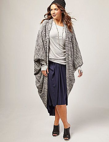 Metallic. Dolman sleeves. And an easy drape that reaches all the way down to your calves. Wrap yourself in a cocoon sweater that perfectly toes the line between relaxed and glam. From our collaboration with a super-talented team of fashion design students from L.A.'s Otis College of Art and Design. lanebryant.com