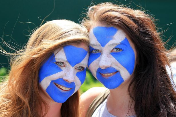 Fan power: Two fans don face paint to support Wimbledon's Braveheart, Andy Murray