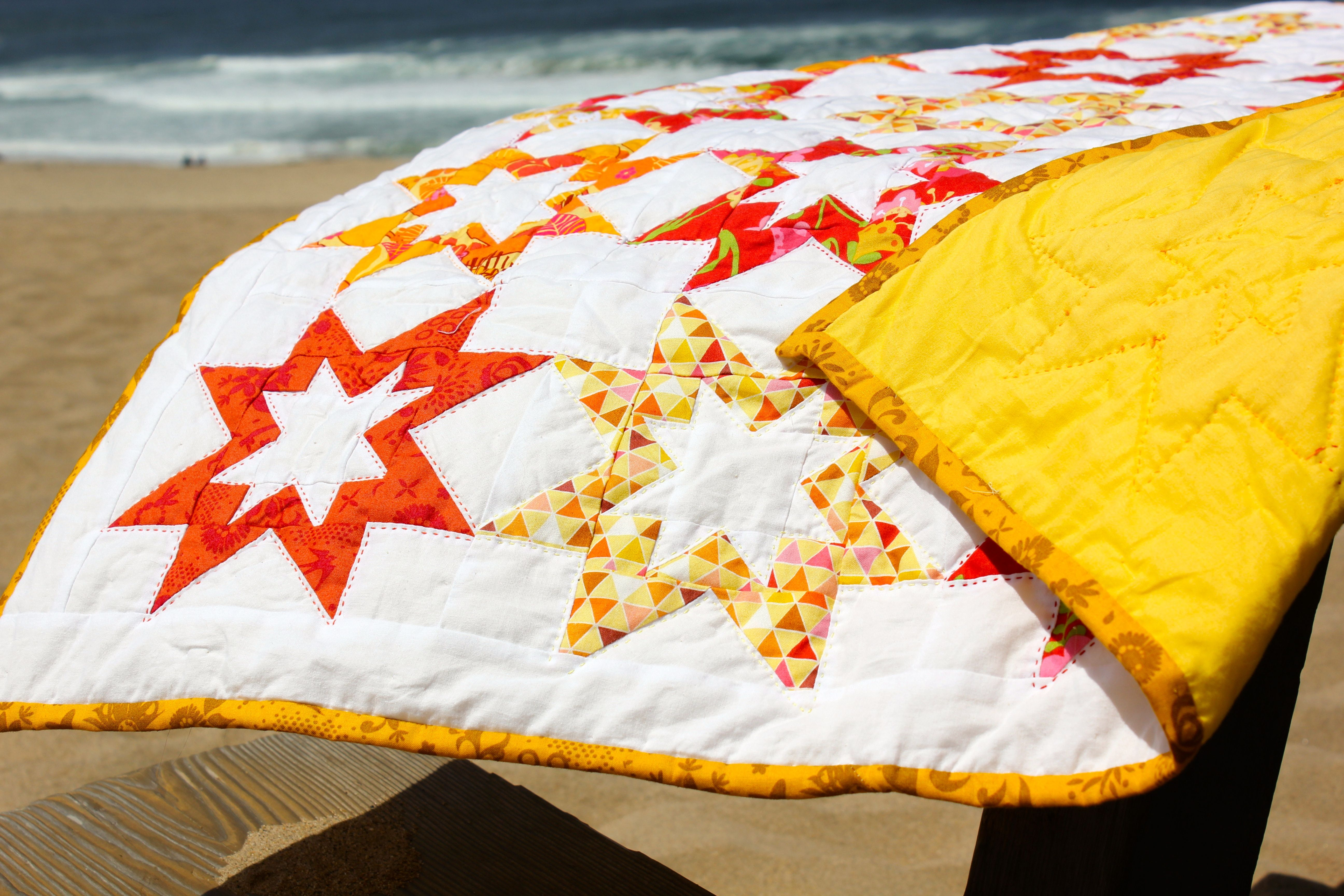 baby girl sunshine quilt with rising star pattern hand quilted with
