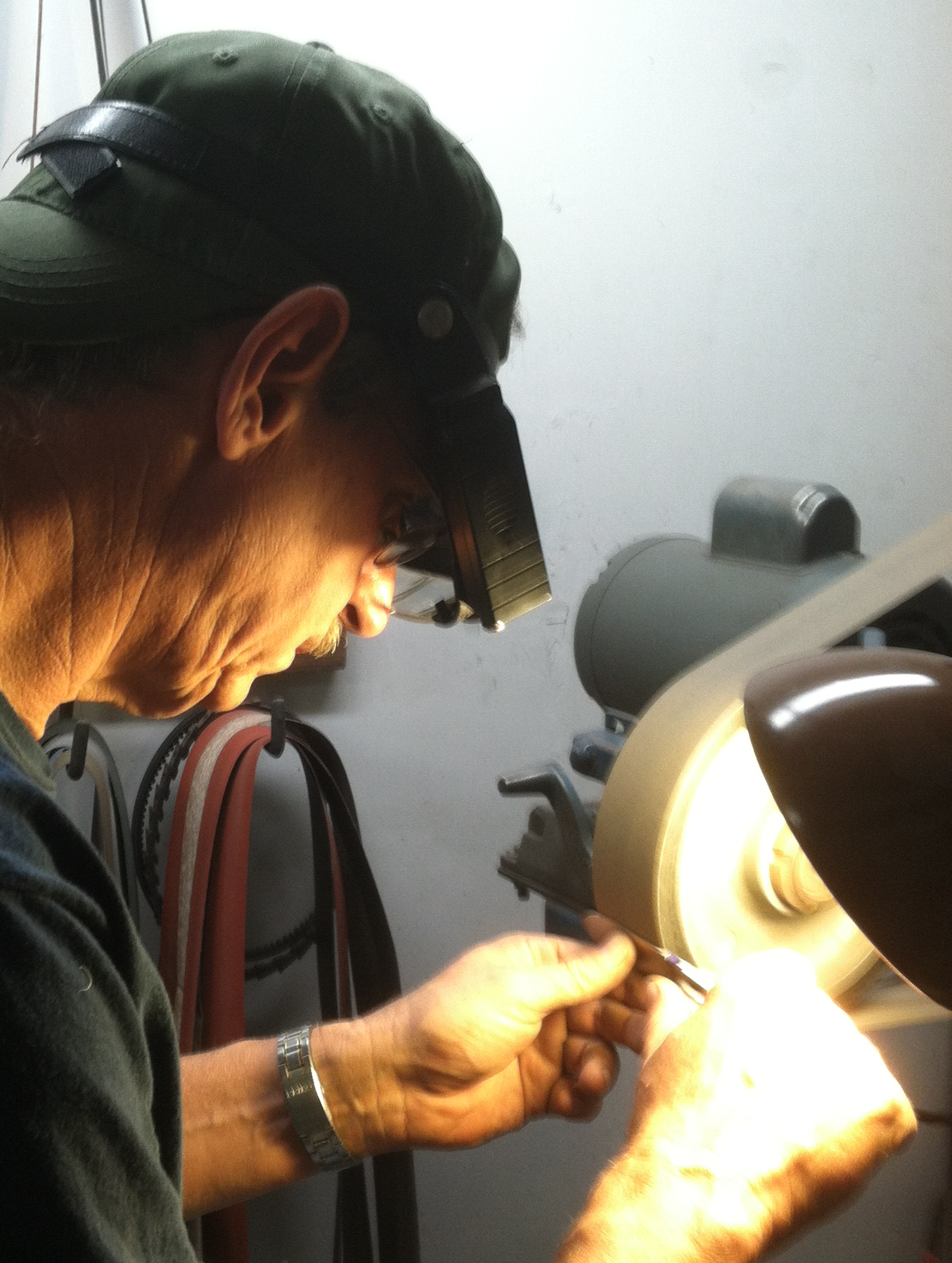 Hand grinding a blade requires a hi degree of skill, lots of patience and a keen eye for symmetry, shape and style - as one mistake can ruin a very expensive custom blade.