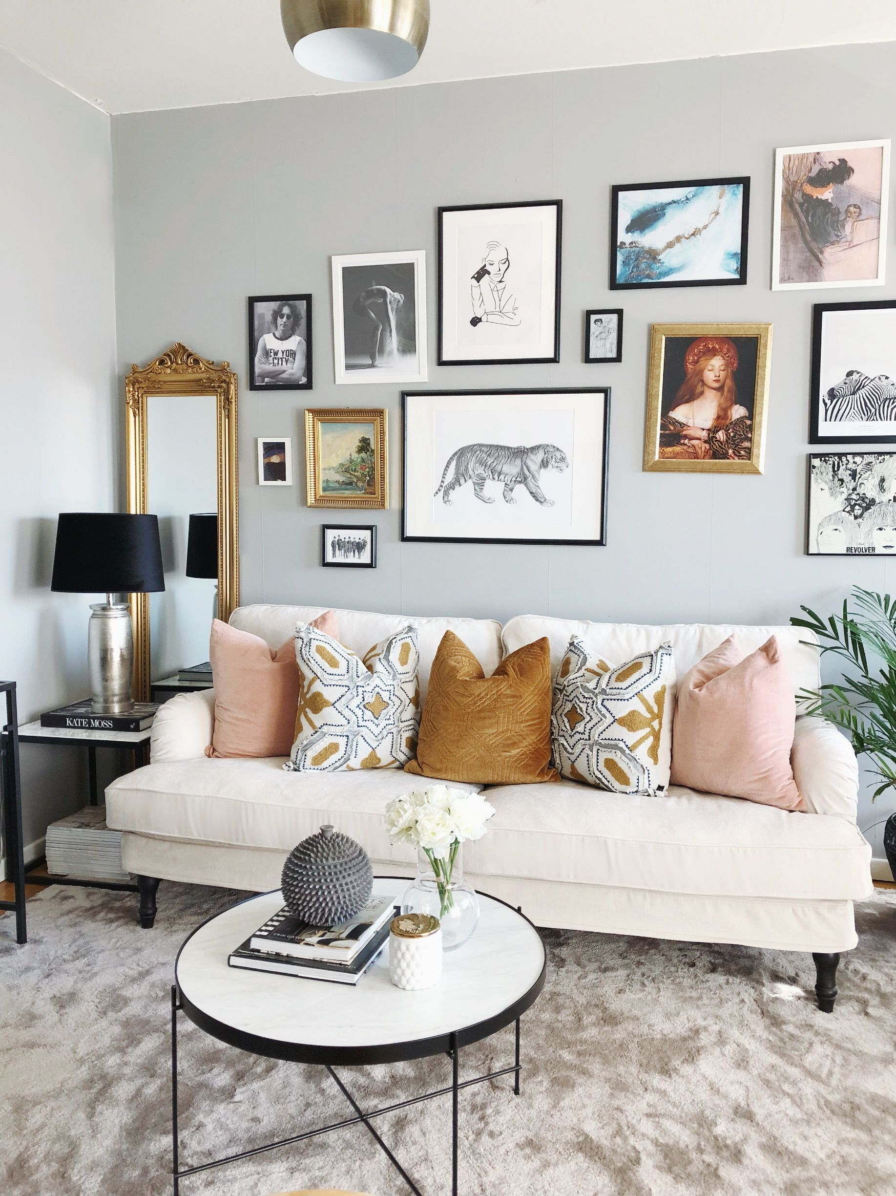 Eclectic Glam Living Room Featuring A White Howard Style Sofa