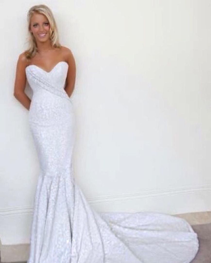 How much is a wedding dress  Wow this dress looks a lot like the one my wife had when we were