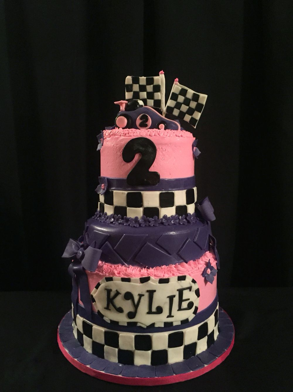 This is the cutest Pink and Purple Race Car Cake for an adorable 2
