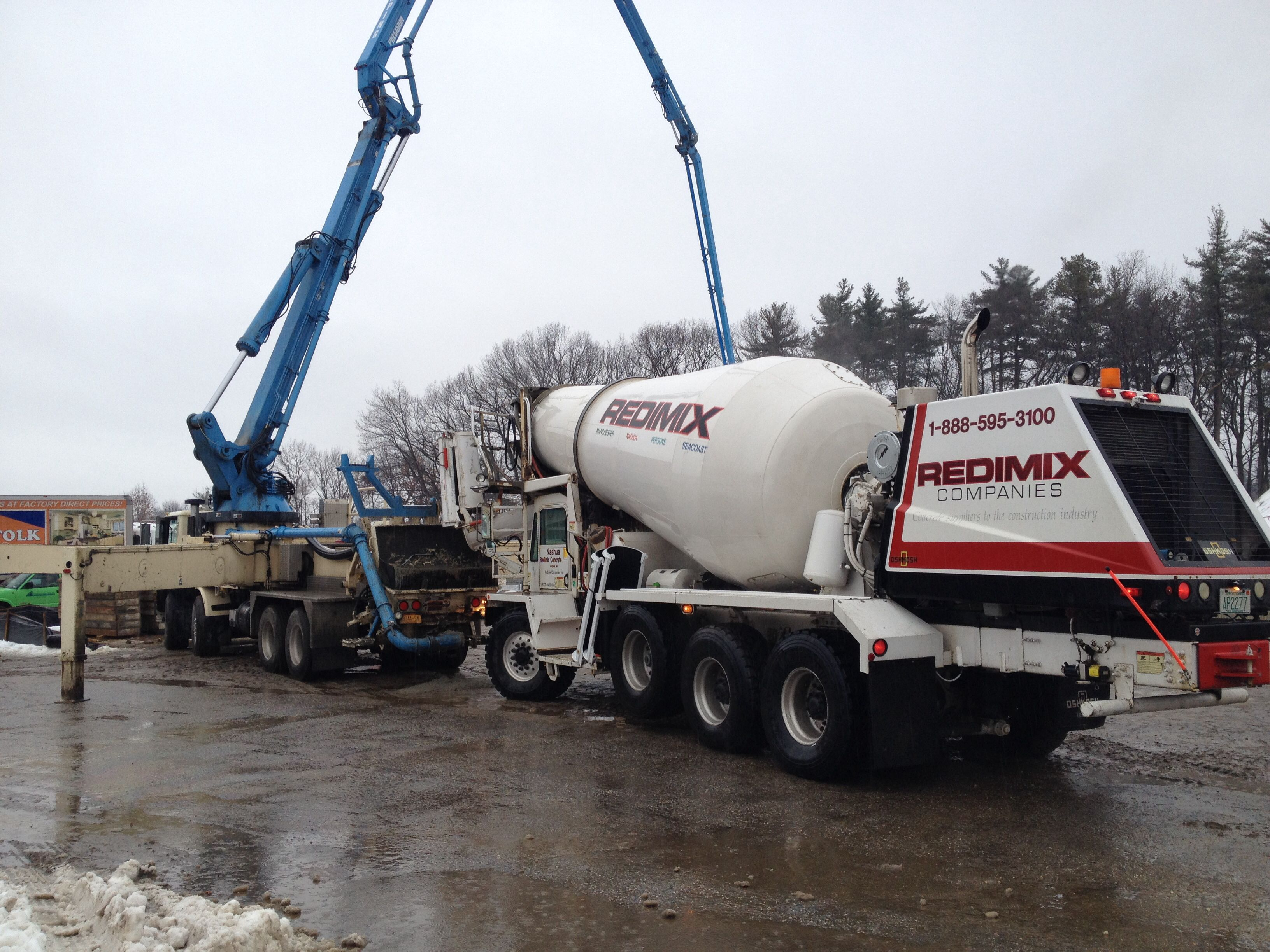 My oshkosh mixer pouring concrete in to a pump truck