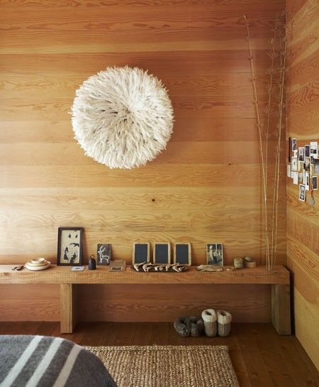 Cultural Accents --- White Bamileke Feather Headdress (Juju hat) on a timber panelled wall