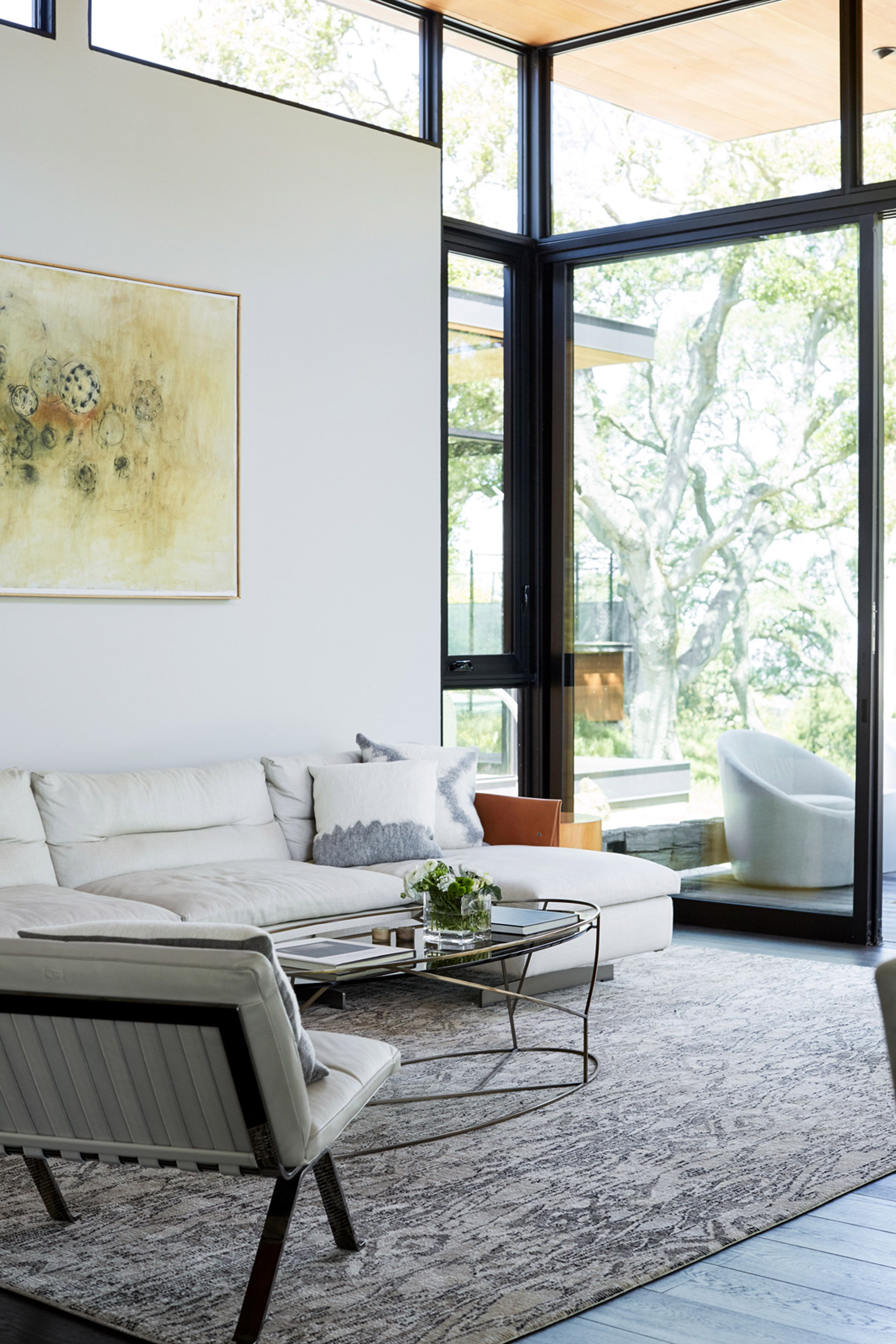 Warm wooden ceilings lend a soft touch to rooms awash in grey and ...