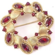 http://www.ebay.com/itm/Vintage-Gold-Tone-Signed-TRIFARI-Hammered-Round-Red-Rhinestone-Flower-Pin-Brooch-/131452405558?pt=LH_DefaultDomain_0&hash=item1e9b2c8736