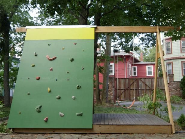 Instead of a standard jungle gym for the kids, build a combination A-frame fort, swing set and climbing wall.