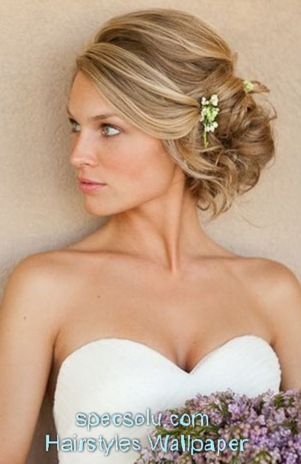Revishing Heart Shaped Face Woman With Bun And Flowers Accessories On Layered Medium Golden Blonde Diy Wedding Hai Wedding Hair Side Long Hair Updo Hair Styles