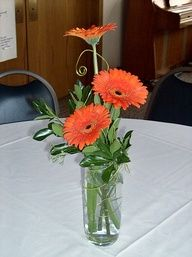 Orange Gerbera Daisies With Wire Centerpiece With Images Daisy