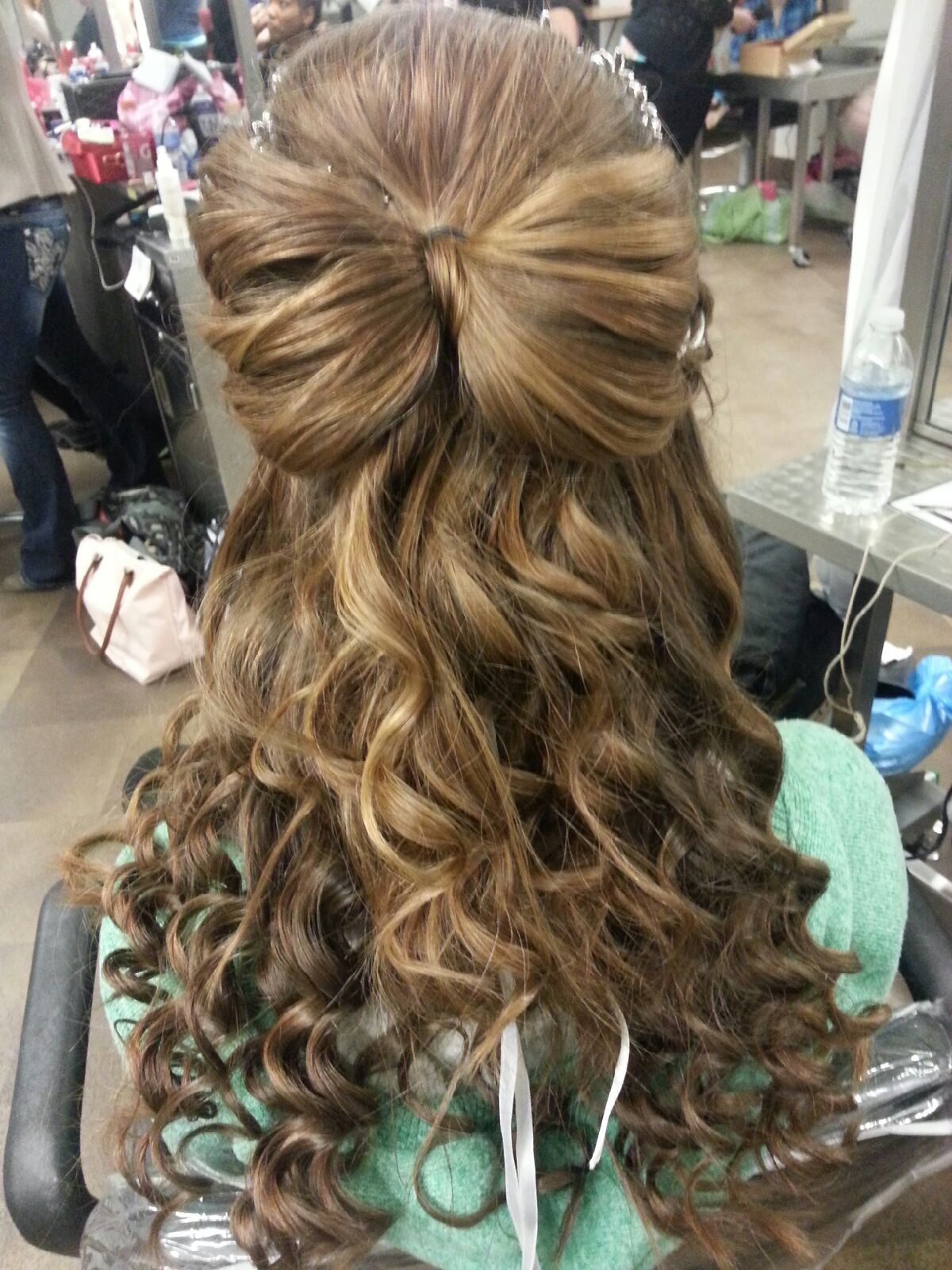 curly hair with a back bump and hairbow made out of hair. <3
