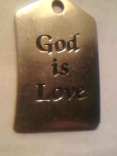 god is love made by RUSS it is BRASS