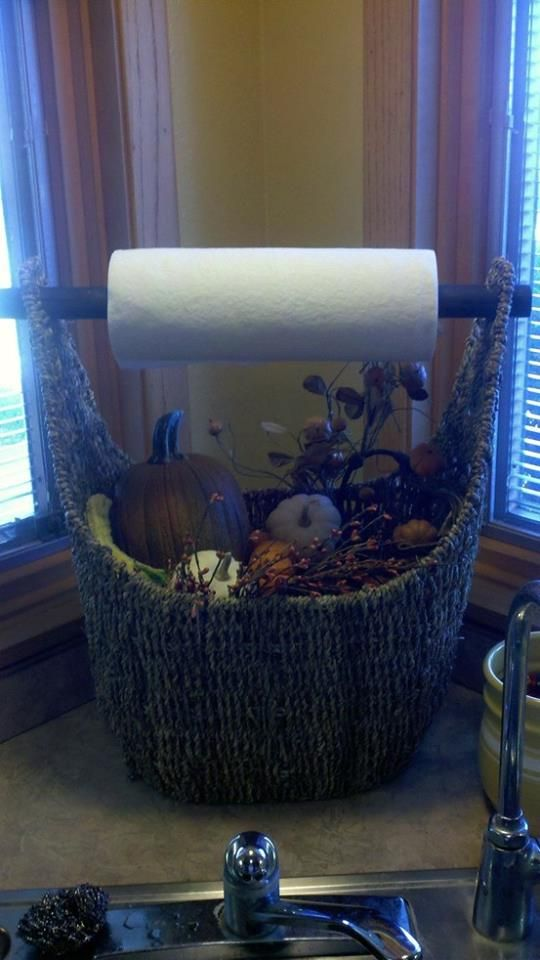 Magazine basket to hold paper towels and seasonal decor