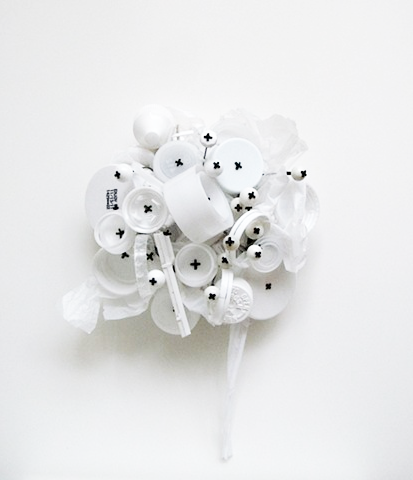 """Susie Ganch, Corsage 1, 2012, Steel, Stainless Steel Cable, Brass, Found trash and beads, 6x6x3.5"""" (USA)"""