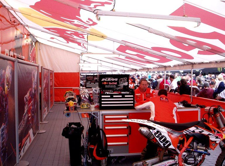 The Ktm Crew Goes To Work Inside Their Canopy While The Crowds Flow By The Half Height Skirts Let The Fans See The Pros At Work Canopy Going To Work Pavilion