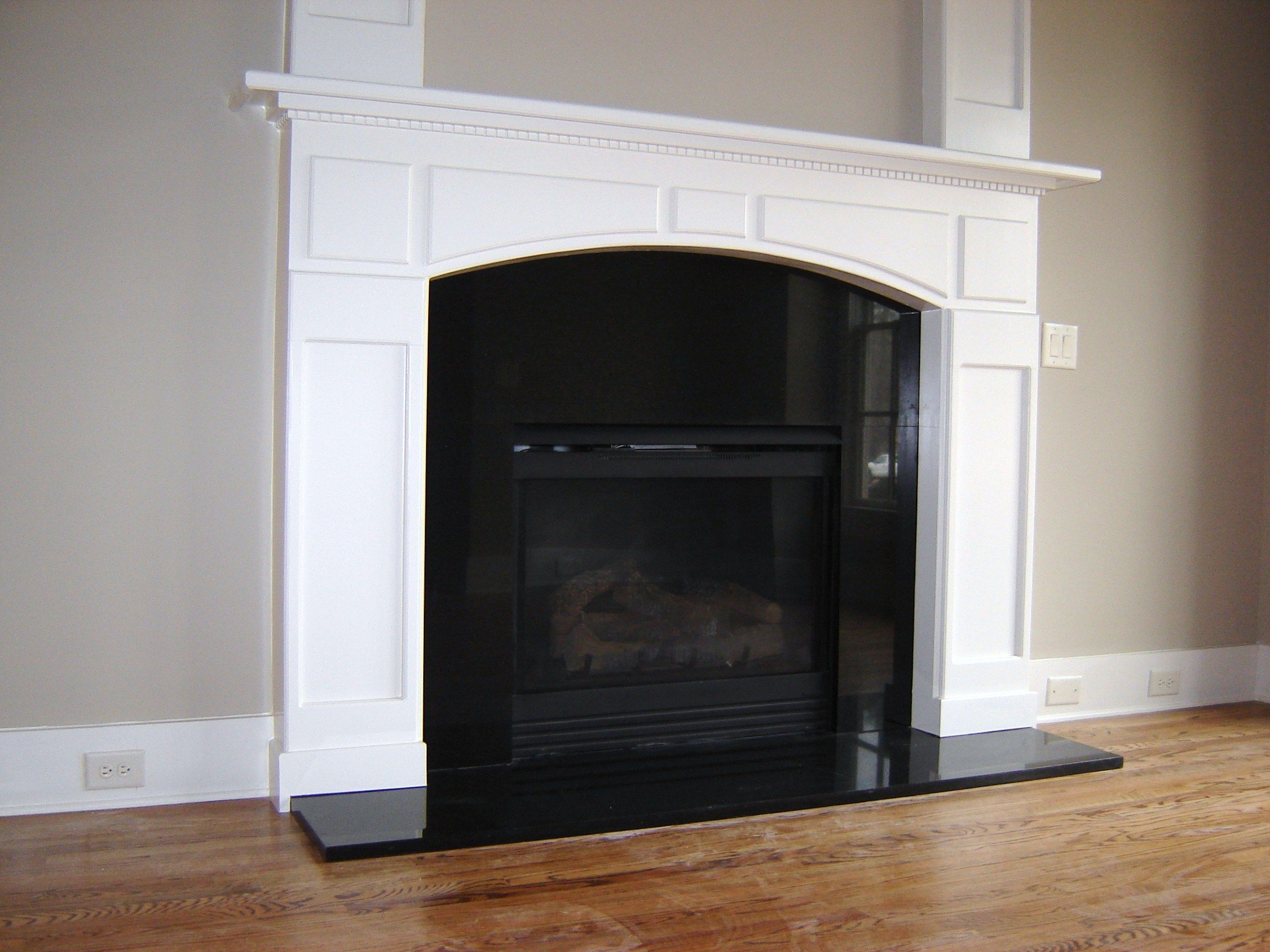 Fireplace hearth and surround. Absolute Black granite. Project ...