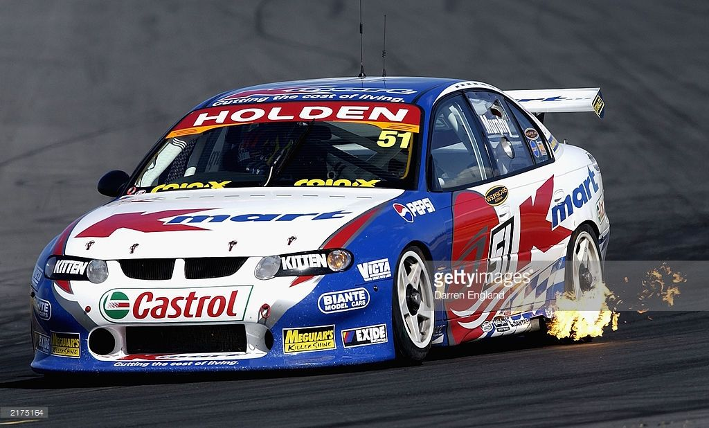 Greg Murphy Of The K Mart Racing Team Holden Commodore In Action Super Cars Holden Commodore Racing Team