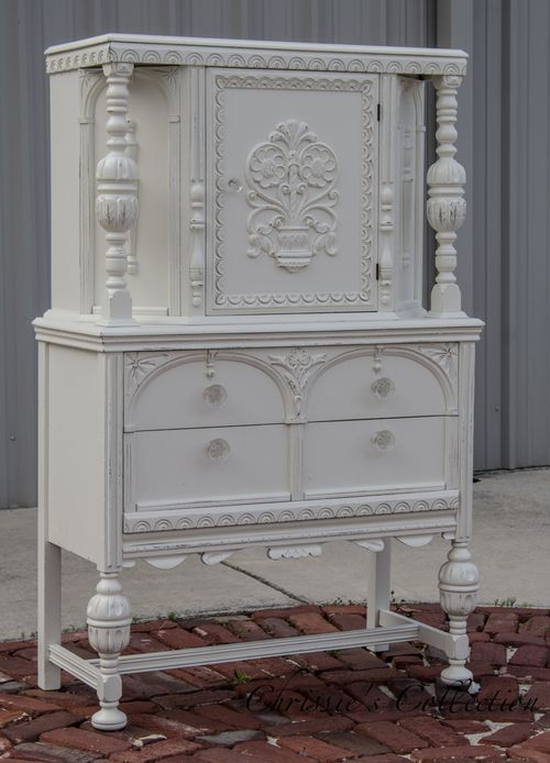 """Antique cabinet painted in General Finishes Antique White with a distressed finish. Measures 40""""x18.5"""" and 62""""t. $425. Currently on display at University Pickers"""