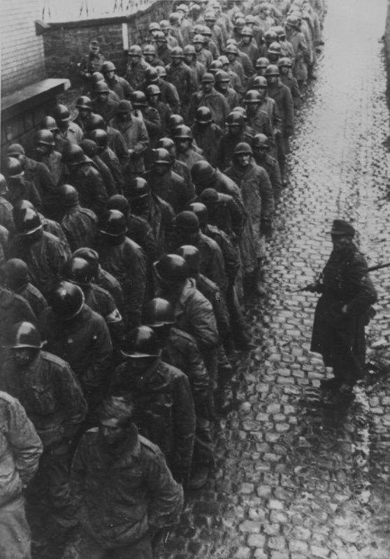 A column of American prisoners of war in the streets of the city under convoy of German soldiers.