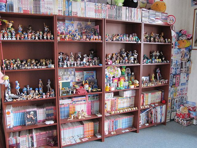 ...I have like 2 mangas and almost 10 figures 3 squishys 1 k-on! purse....I wish my room looked like that....
